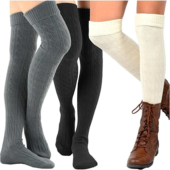 three models from the thigh down wearing cable-knit over the knee socks