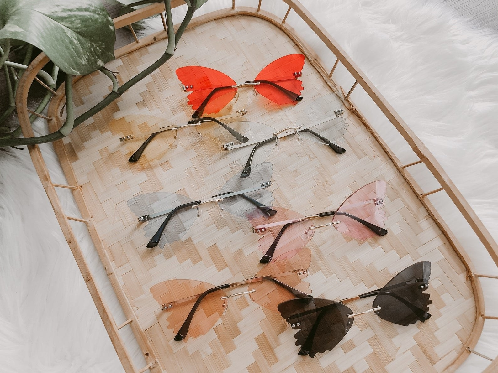 six pairs of sunglasses with frames that are shaped like butterfly wings