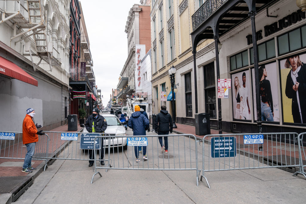 A mostly empty Bourbon Street closed off by barricades