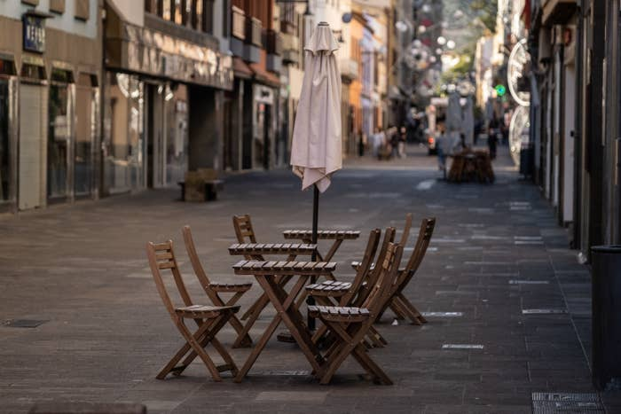 A deserted bar terrace in the otherwise busy street in San Cristobal