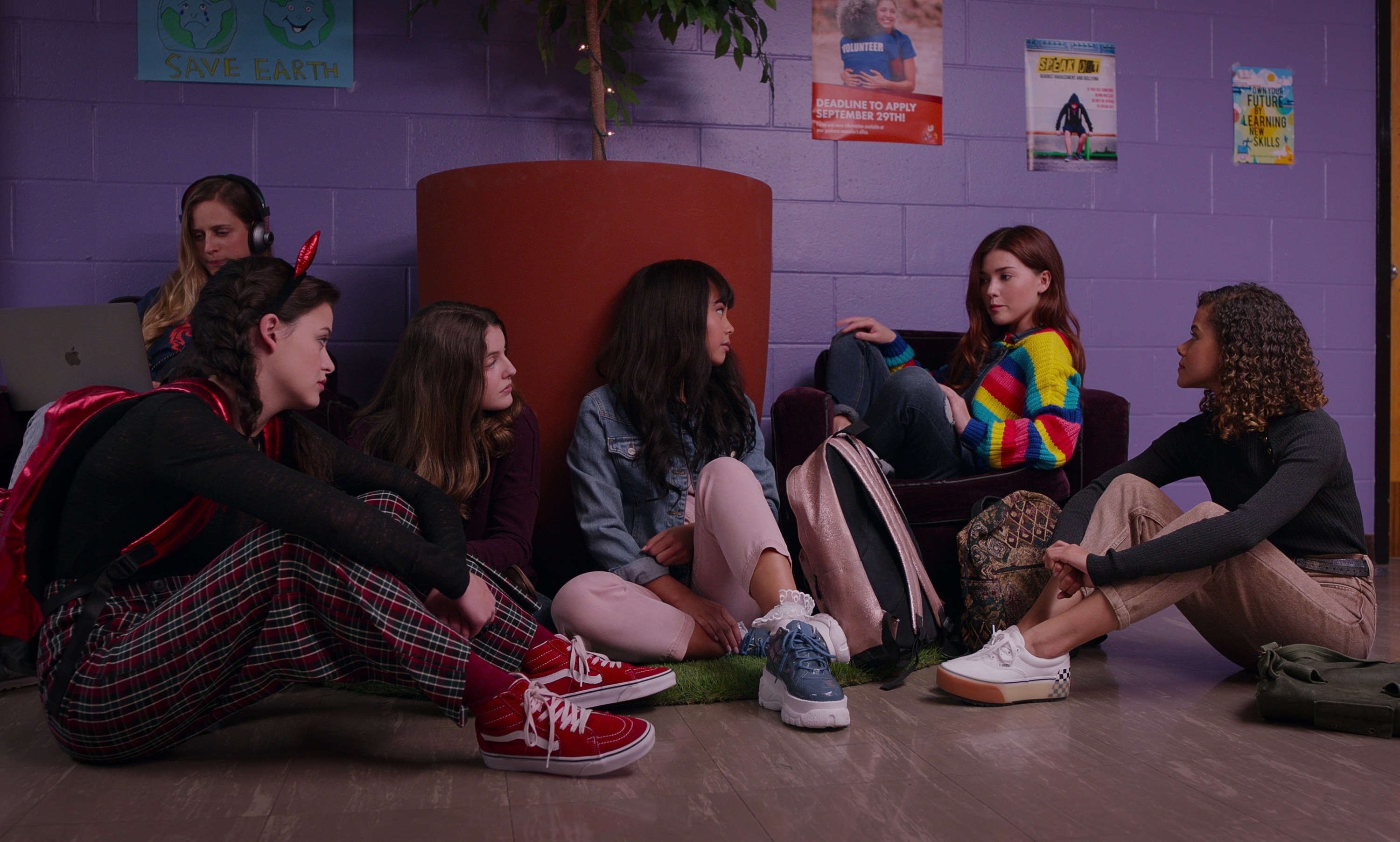 Max, Samantha, Norah, Abby, and Ginny sit on the floor