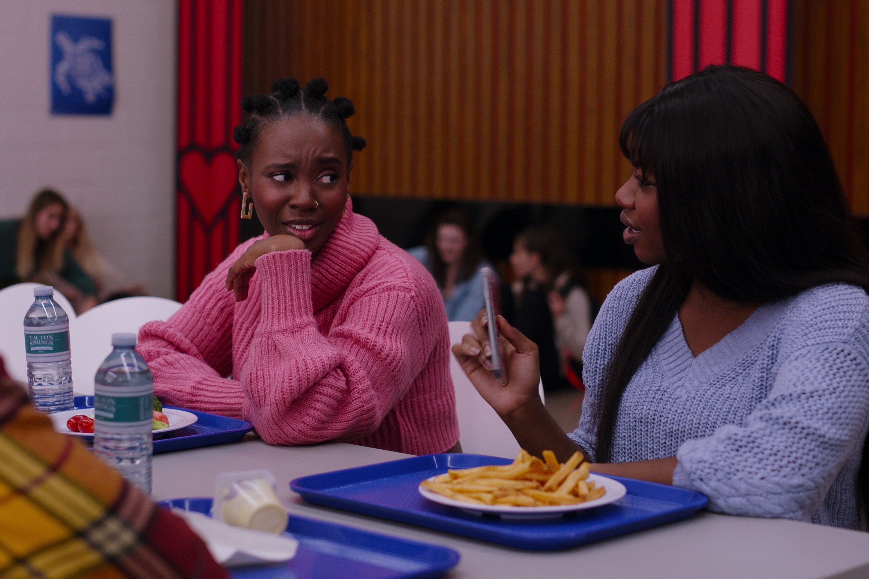 Bracia talks to her friend in the cafeteria