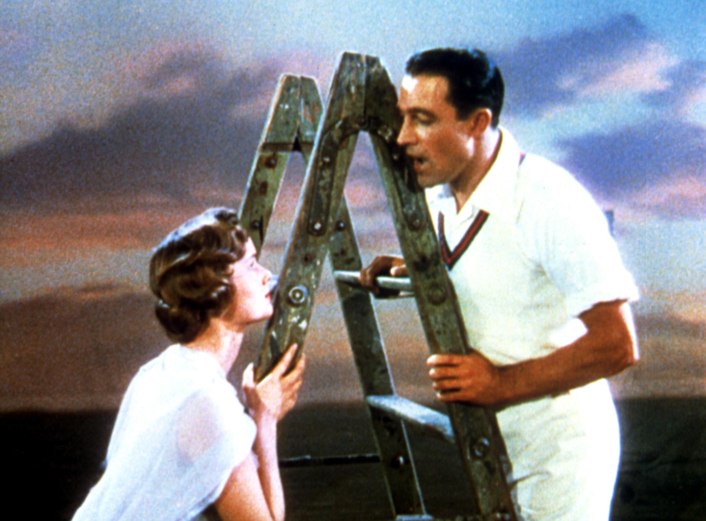 Don and Kathy singing together on a ladder