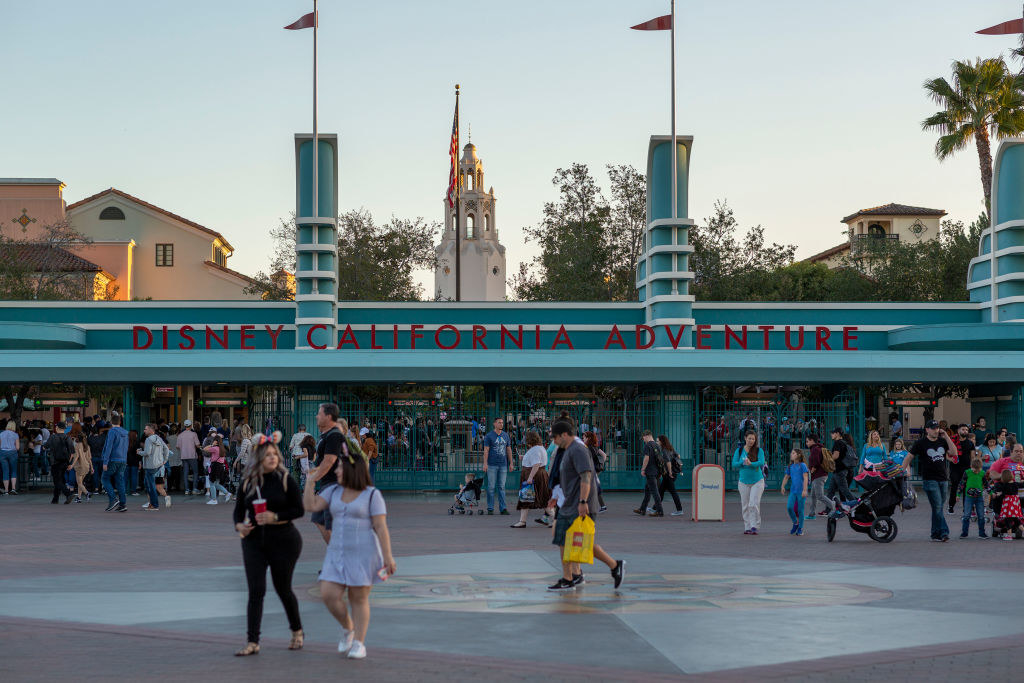 Crowds of people mill about the entrance to California Adventure