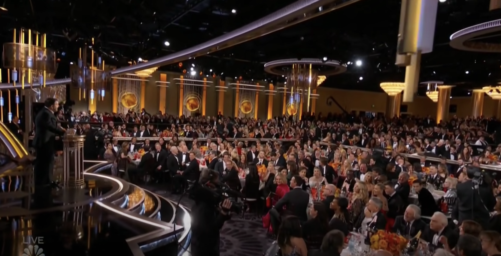 The awards ceremony is filled with celebrities sitting at tables