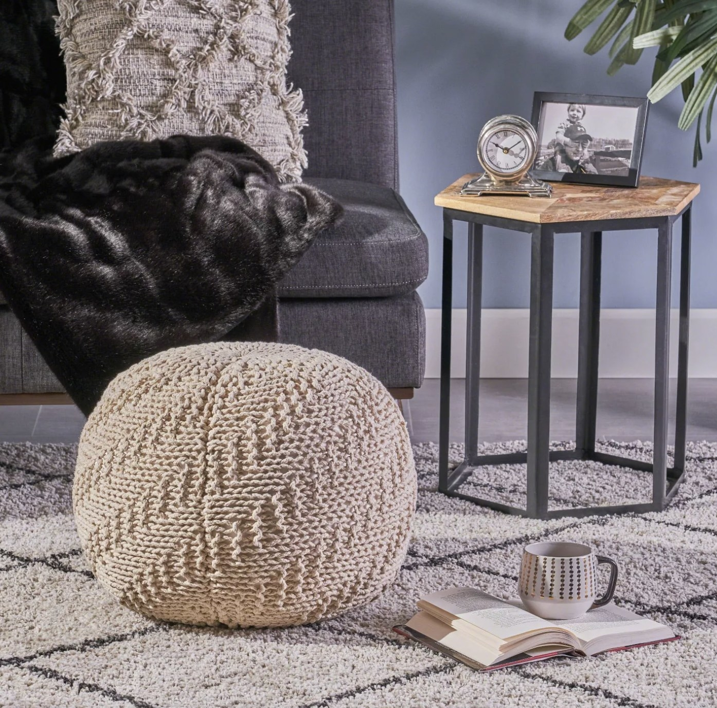 A cream knitted pouf