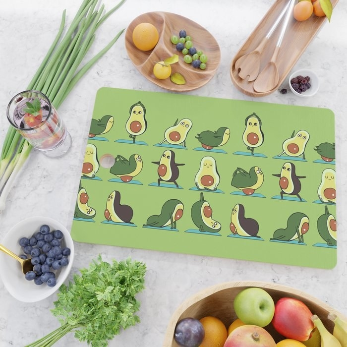 Cutting board with illustrated avocados placed on kitchen counter
