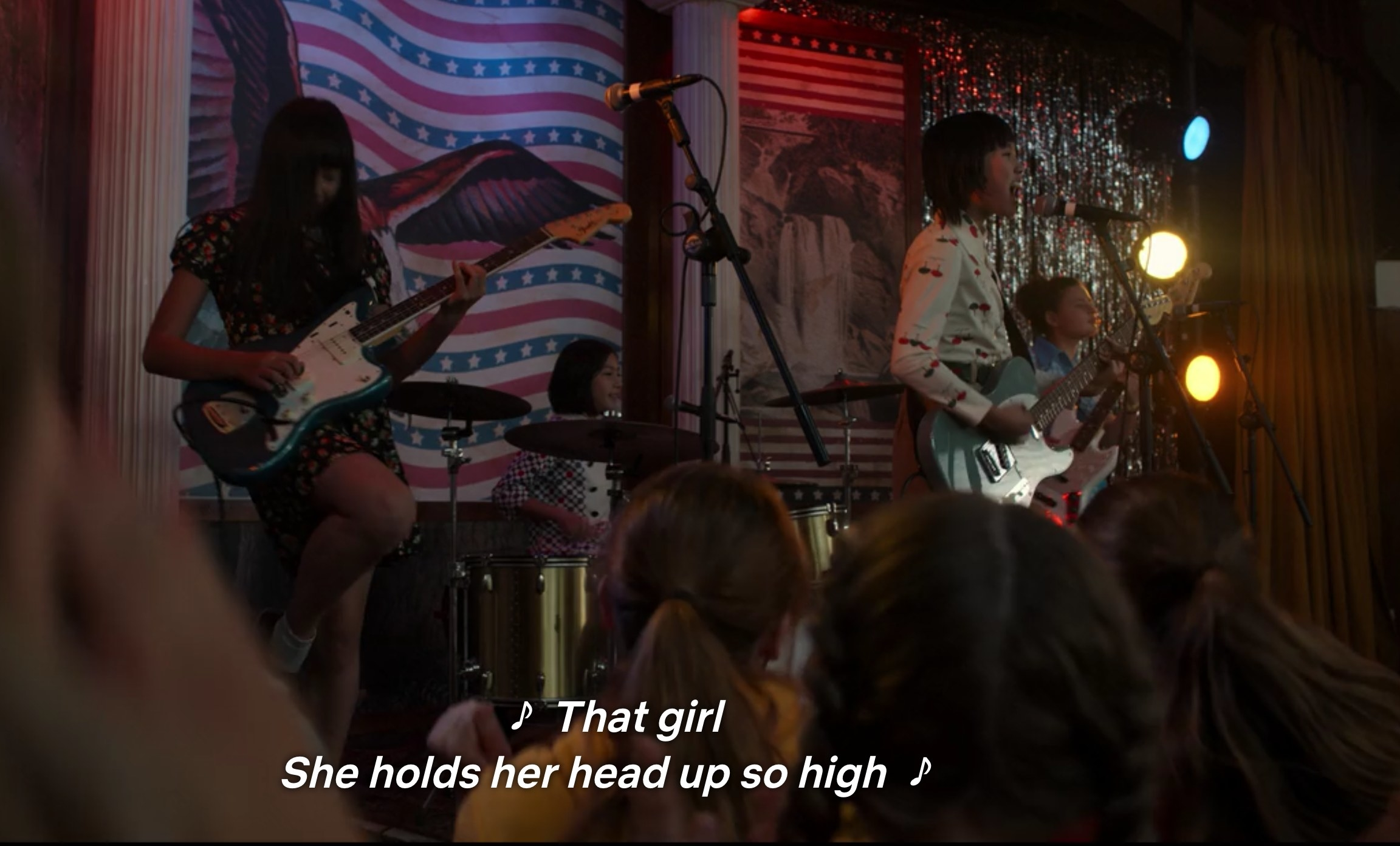 "Punk band singing, ""That girl / She holds her head up so high"""