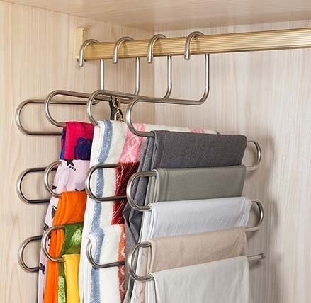 A space saving hanger in a closet with clothes on it