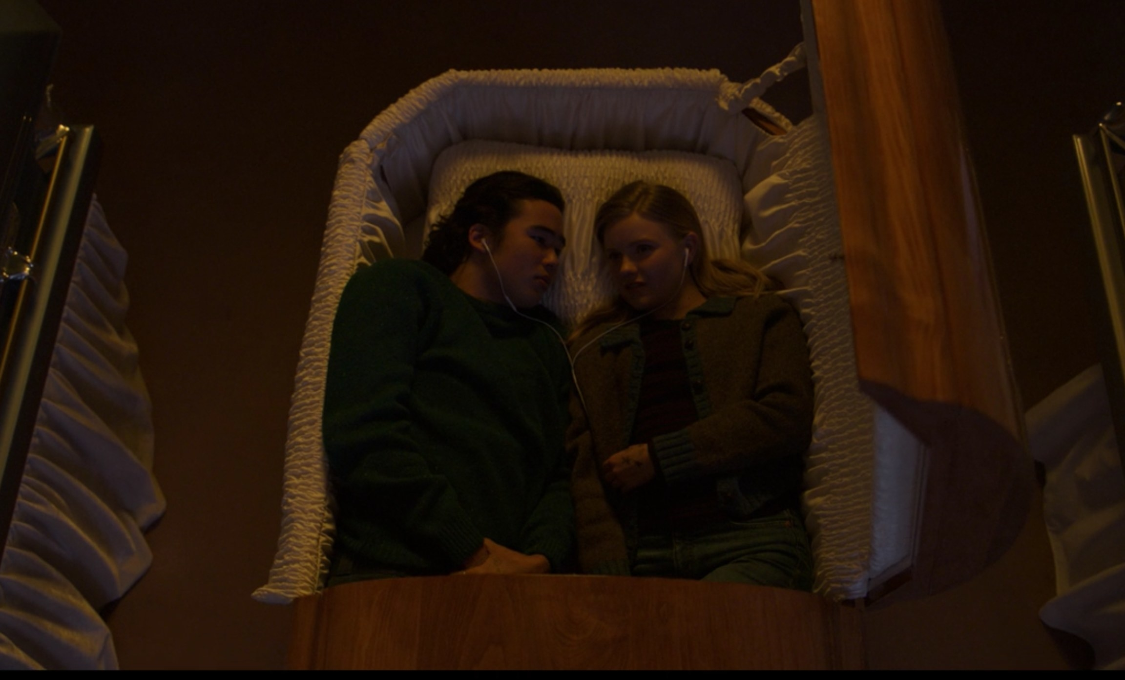 Seth and Viv lie in a coffin together
