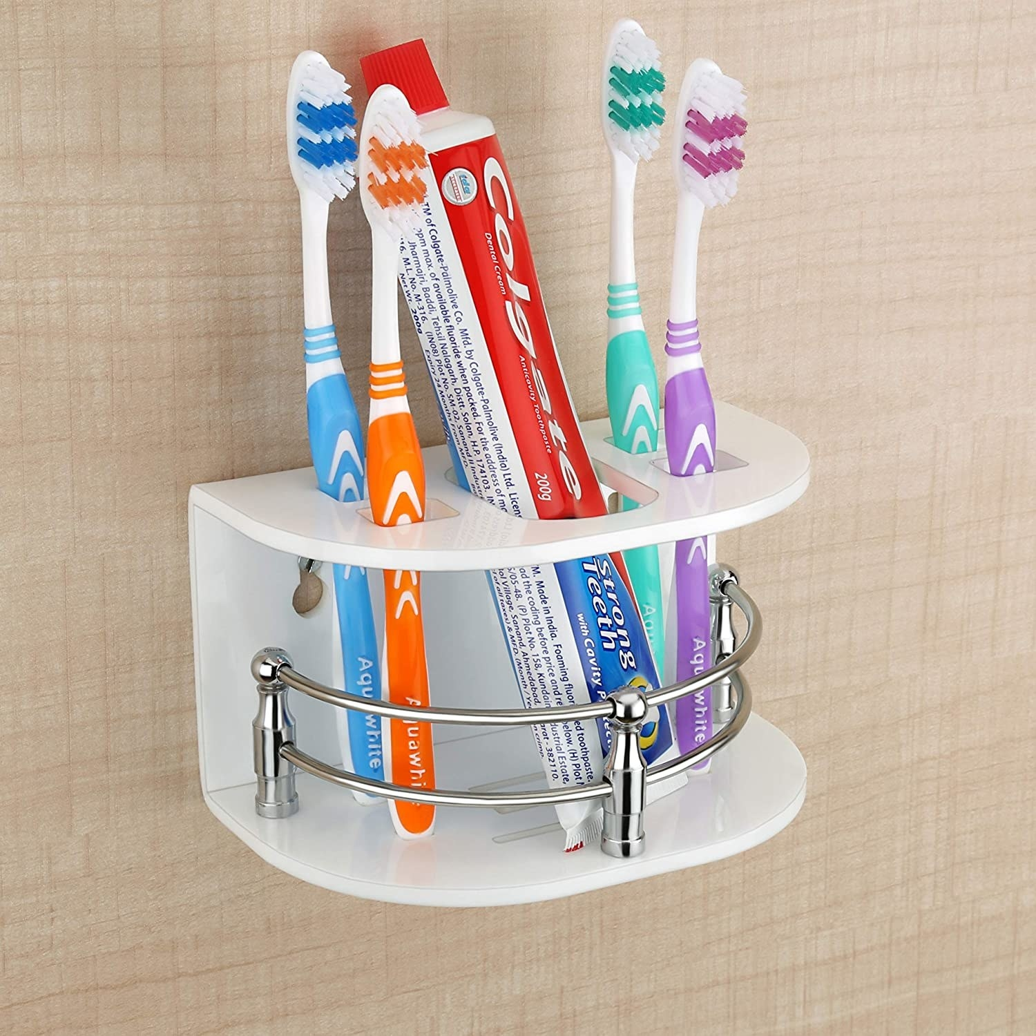 A wall-mounted organiser with toothbrushes and toothpaste in it