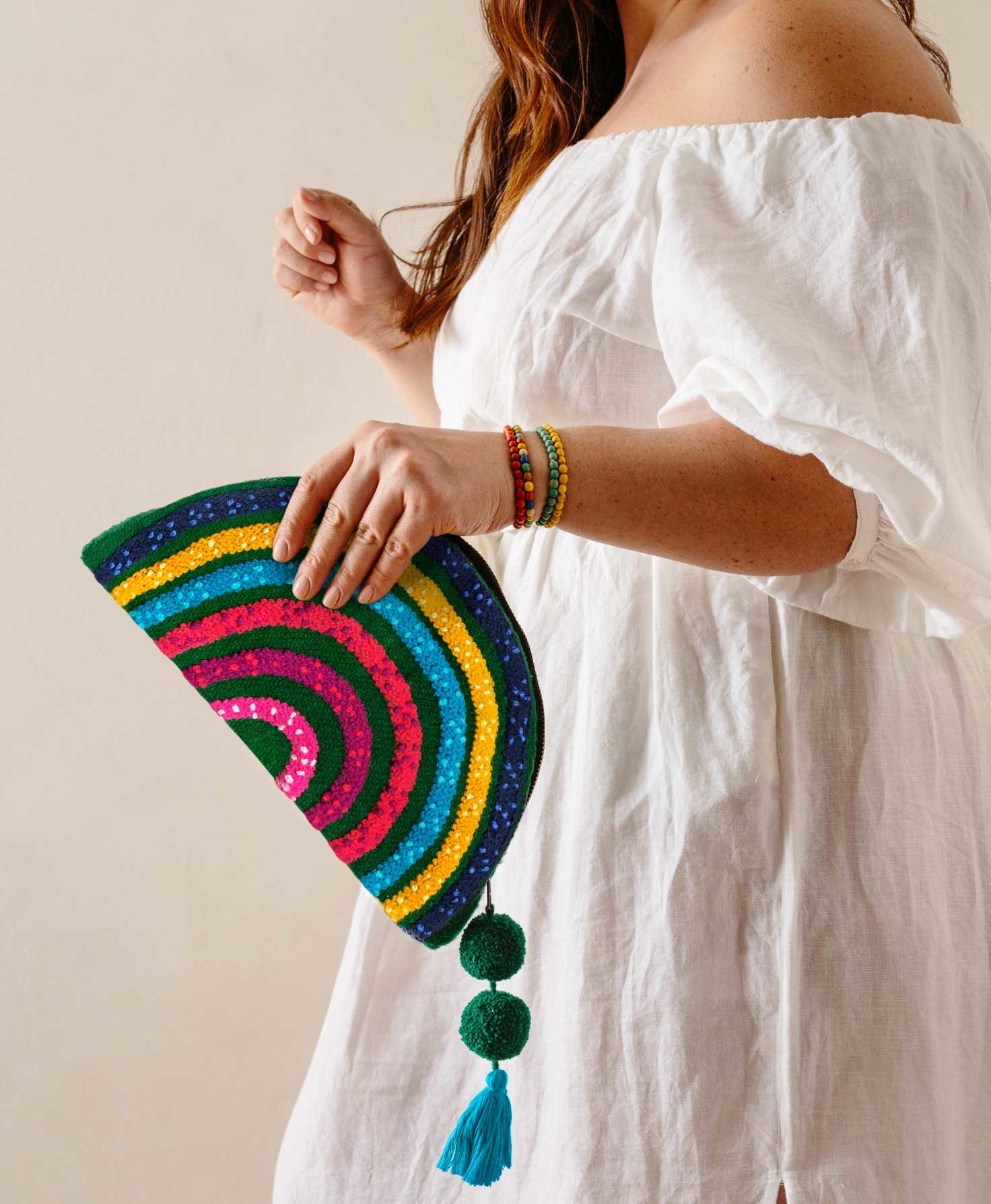 a model holding the rainbow clutch