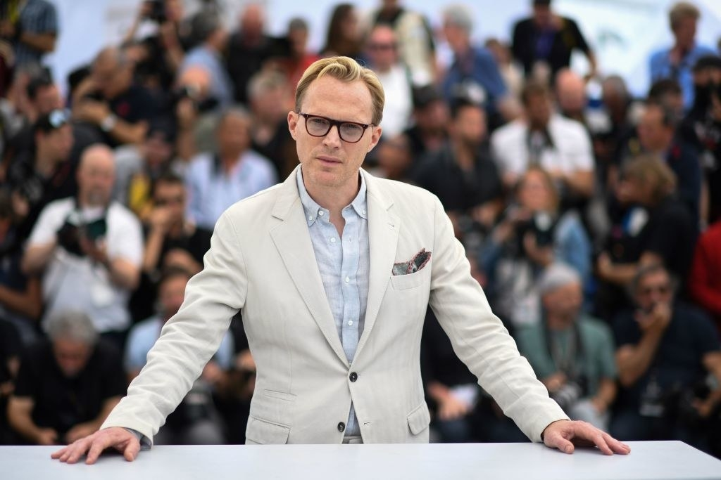 Paul Bettany standing in front of photographers at the Cannes Film Festival