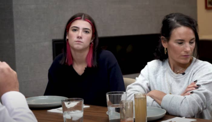 Charli sitting at the dinner table with her family