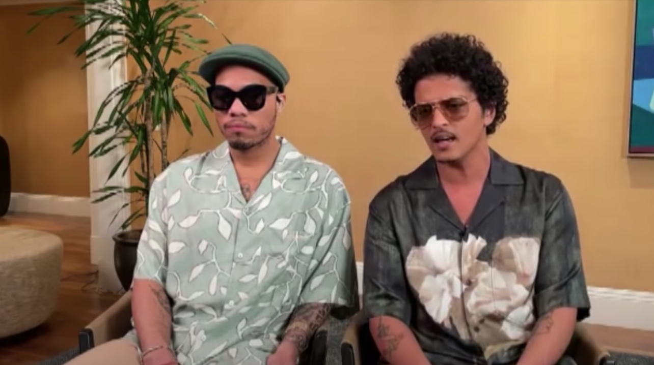 Anderson and Bruno sitting next to each other during an interview
