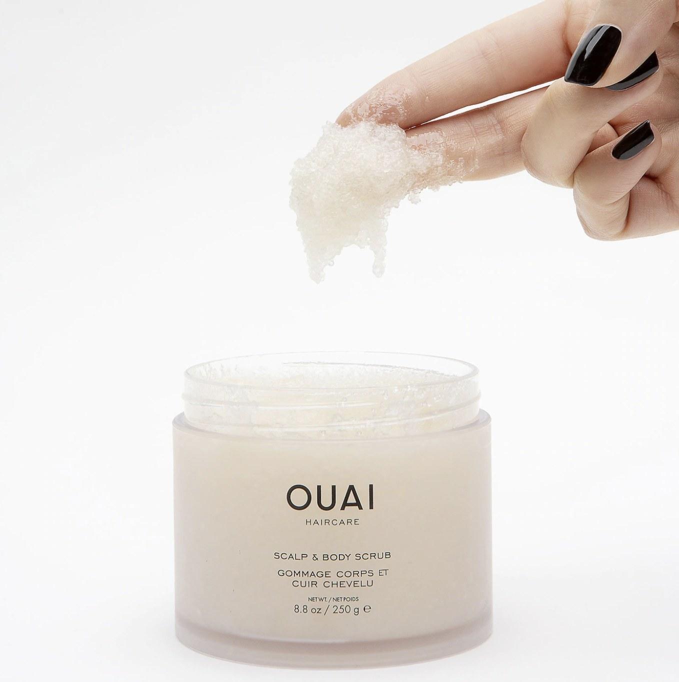 A clear jar of scalp and body scrub