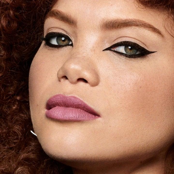 A model wearing a cat eye makeup