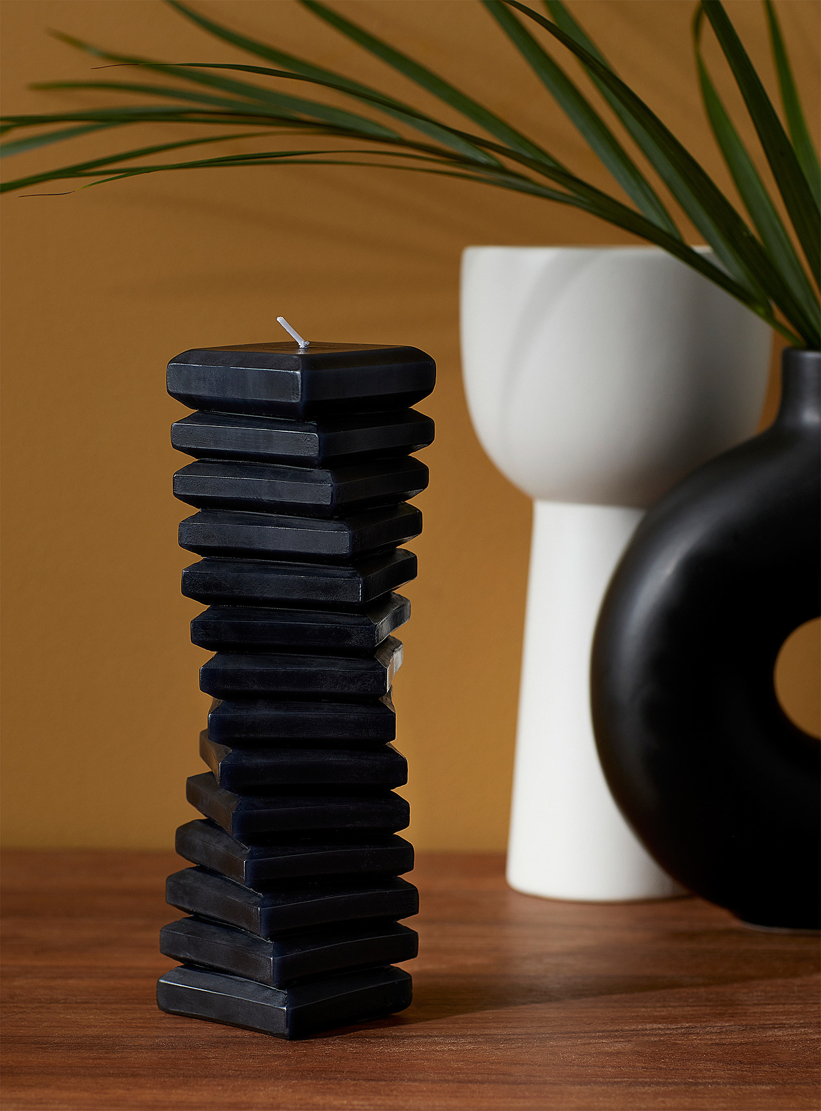 A tall thin spiral shaped candle