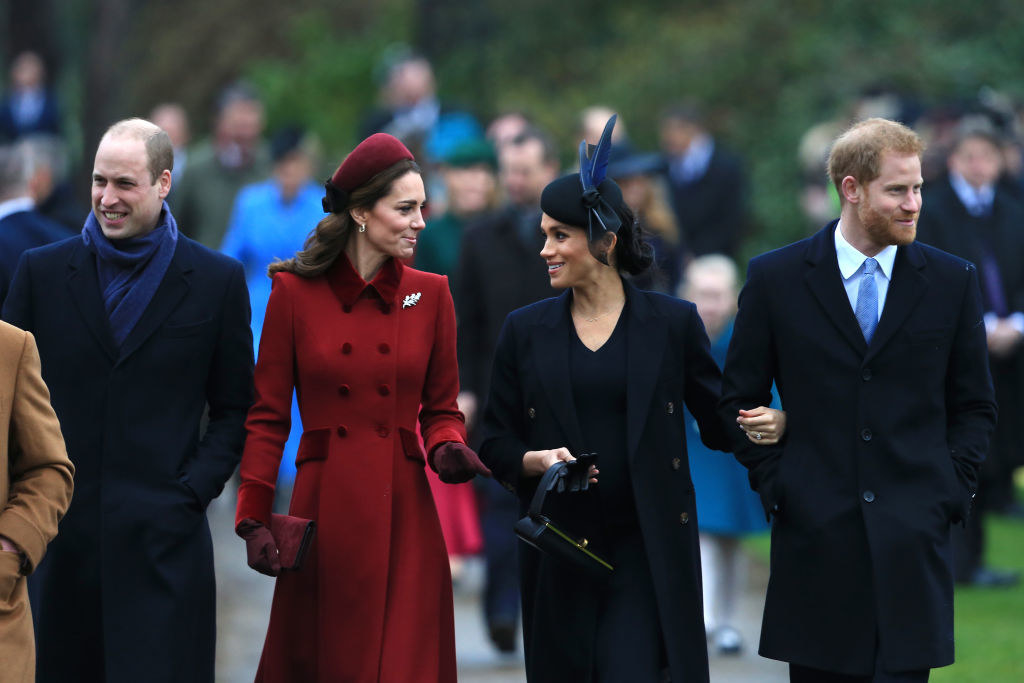 William, Kate, Meghan, and Harry walking together during the Christmas holidays