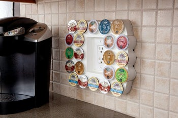 The rectangular organizer around an outlet holding coffee pods