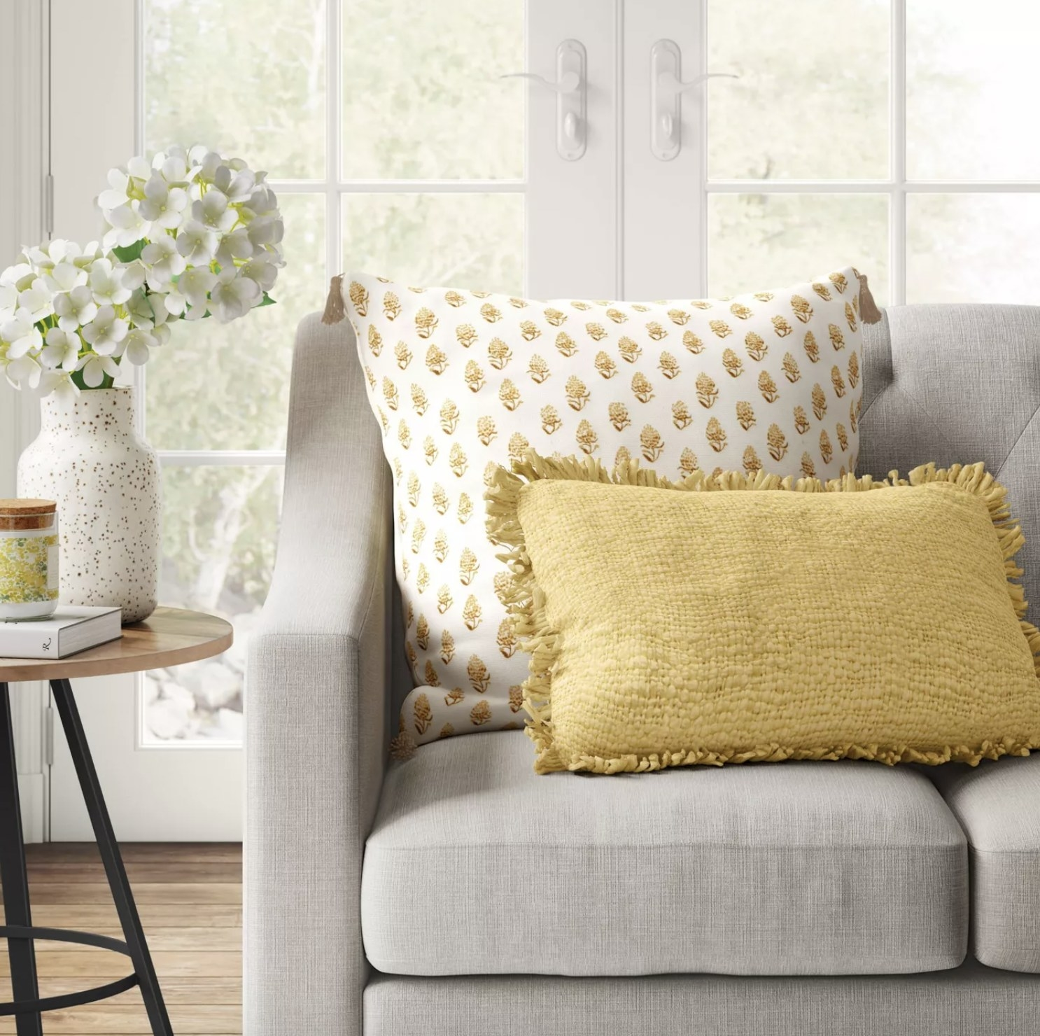 Decorative throw pillow styled on couch.