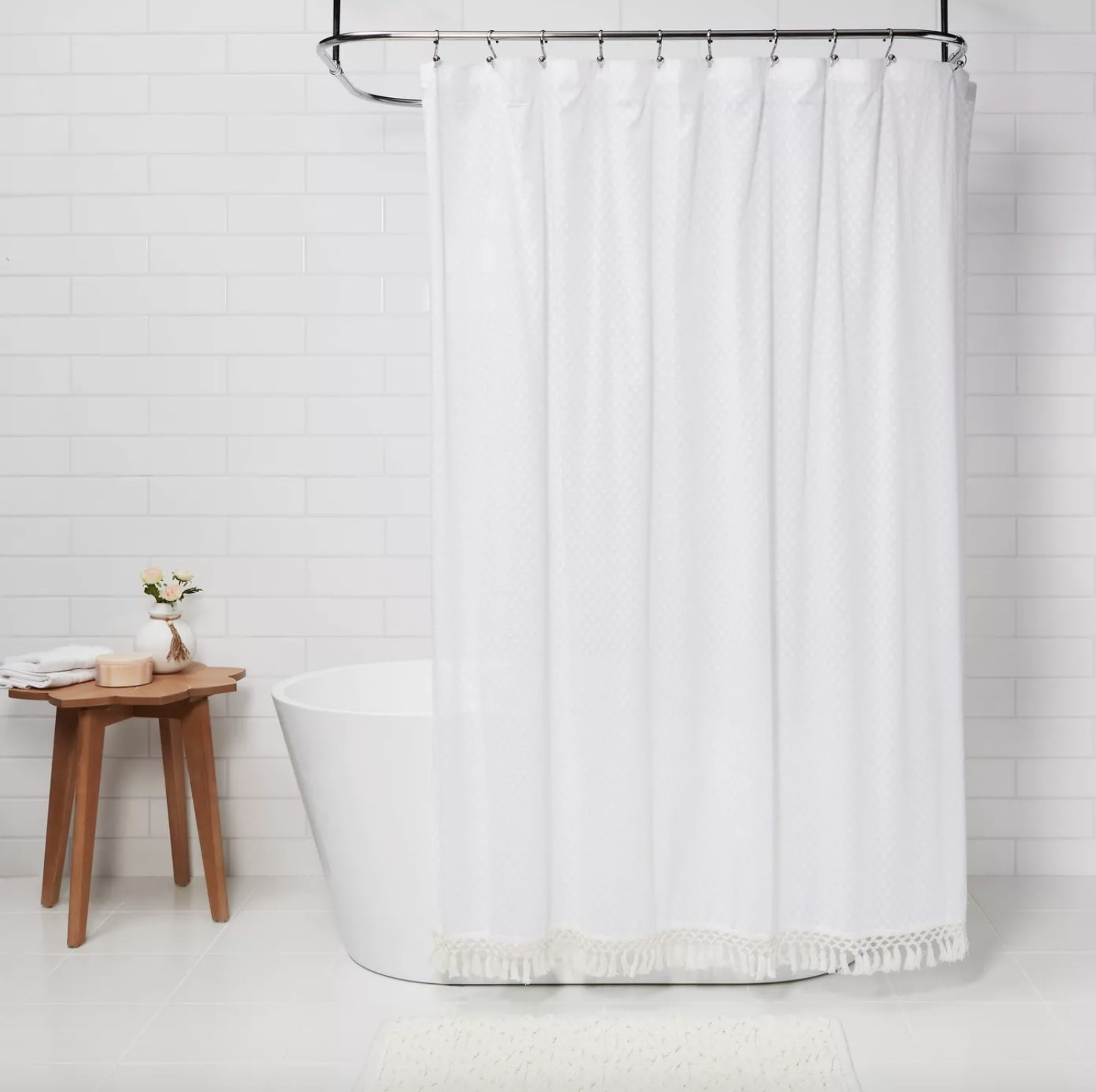 Shower curtain hung on shower rod.