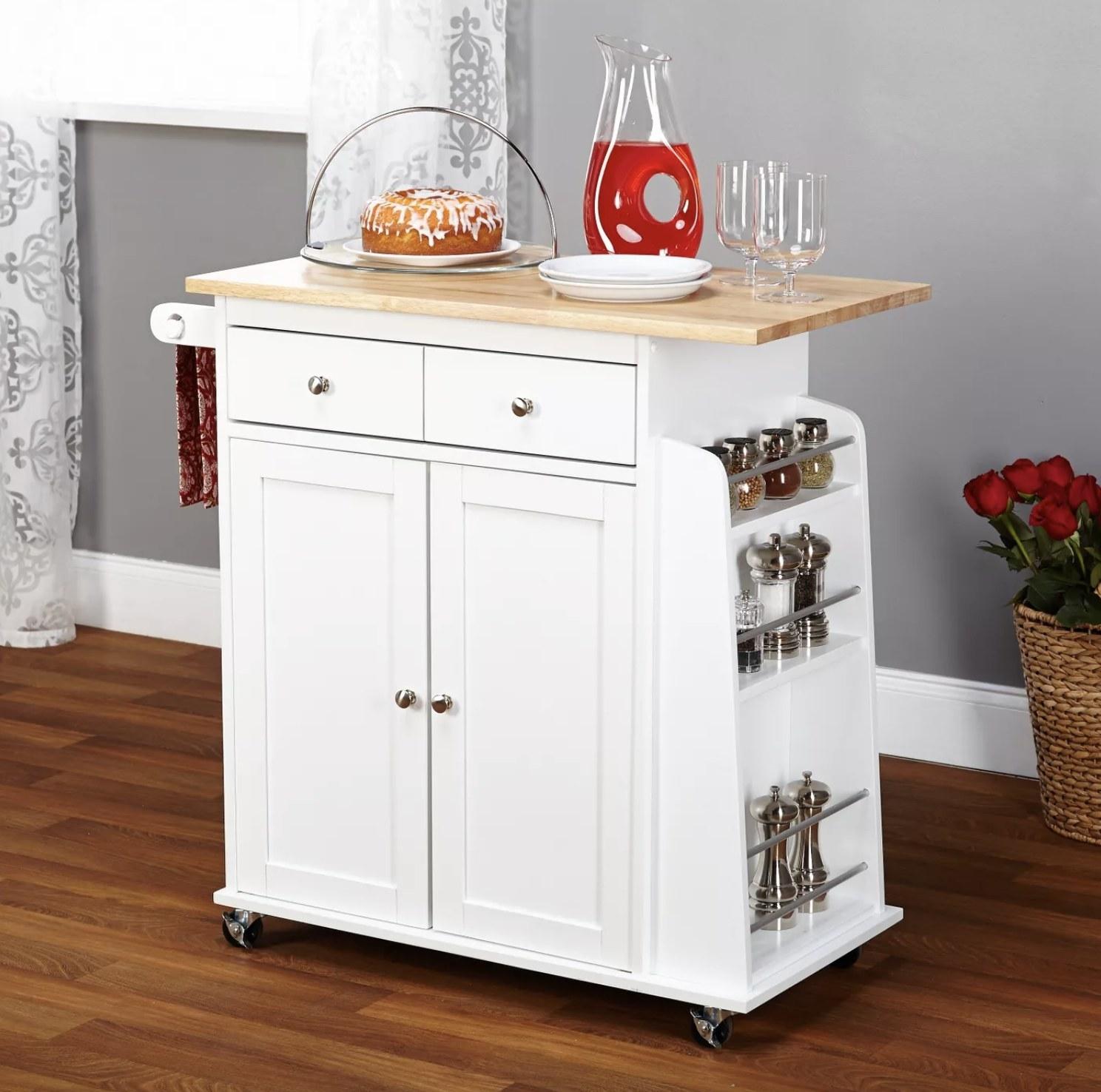Kitchen cart displayed in kitchen.