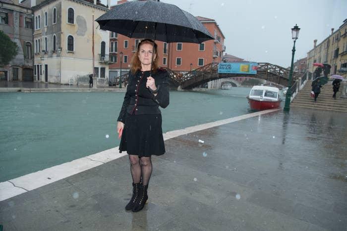 Sarah Ferguson, holding an umbrella, in Venice in 2019