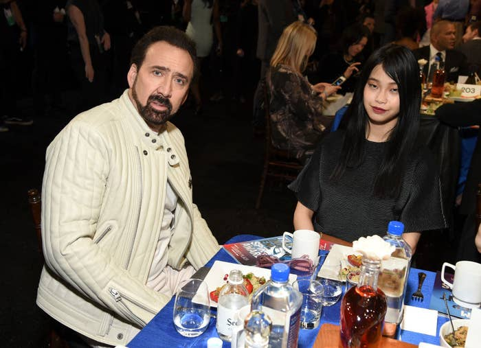 Nicolas Cage  and Riko Shibata sitting at a table and eating at the 2020 Film Independent Spirit Awards