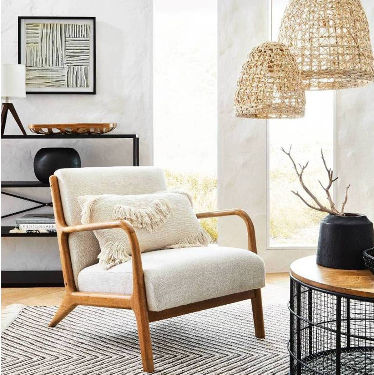 cream colored armchair with wood frame in a living room