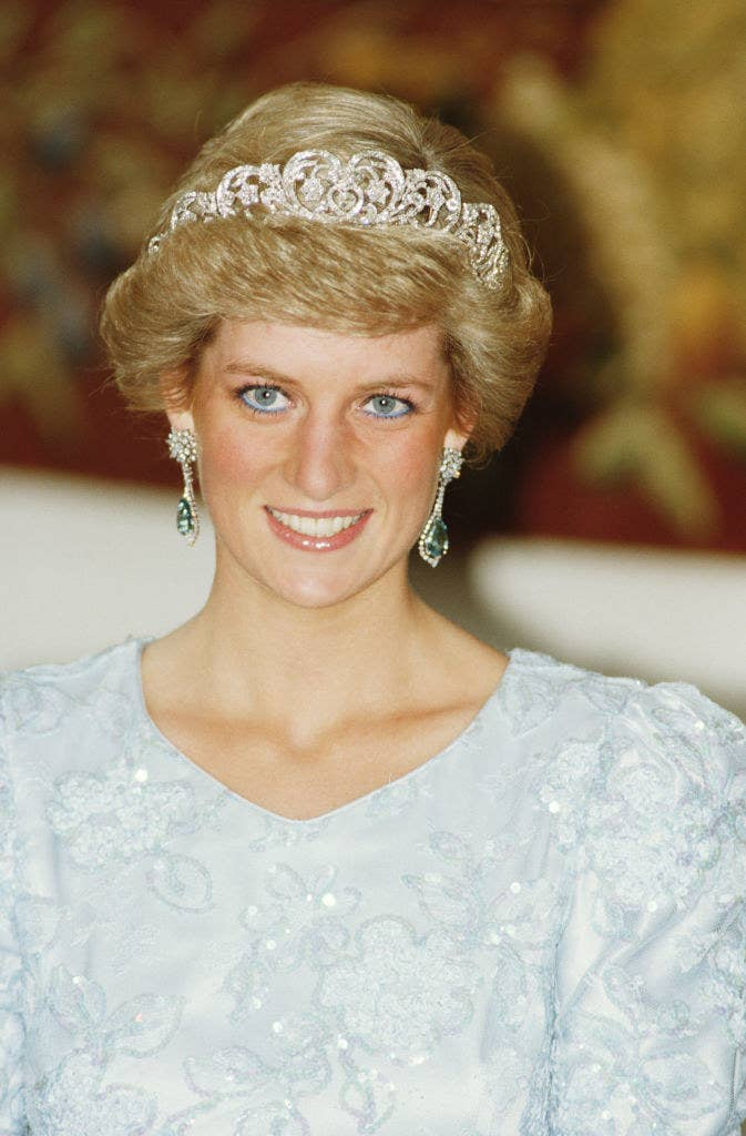 Princess Diana wearing a sequined gown, a tiara, and drop earrings