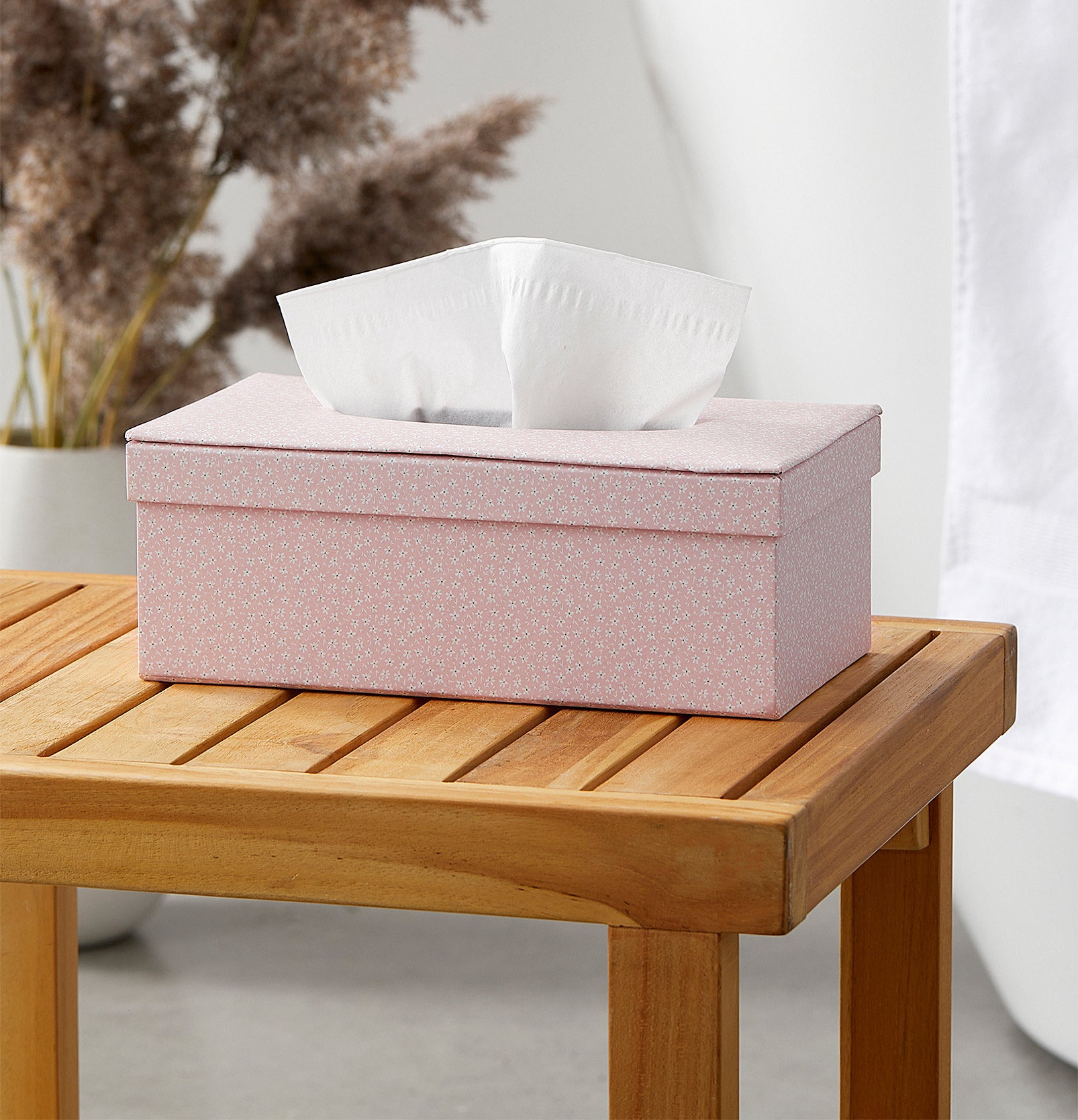 A tissue box on a wooden stool