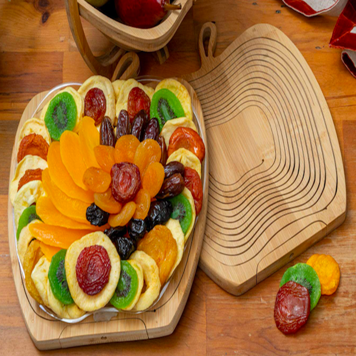 Apple shaped tray with several slices of dried fruit on top