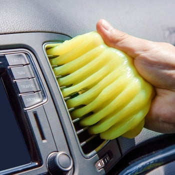 Hand pressing the gel on car air vents