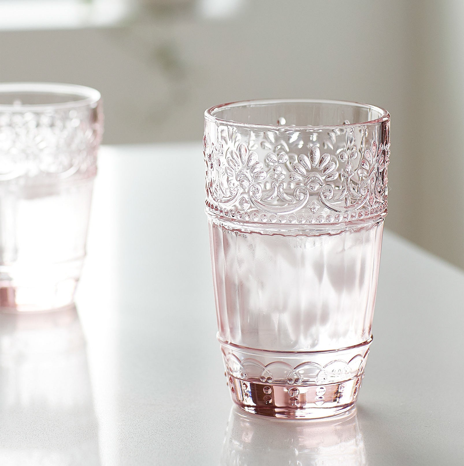 A rosy glass with a floral trim