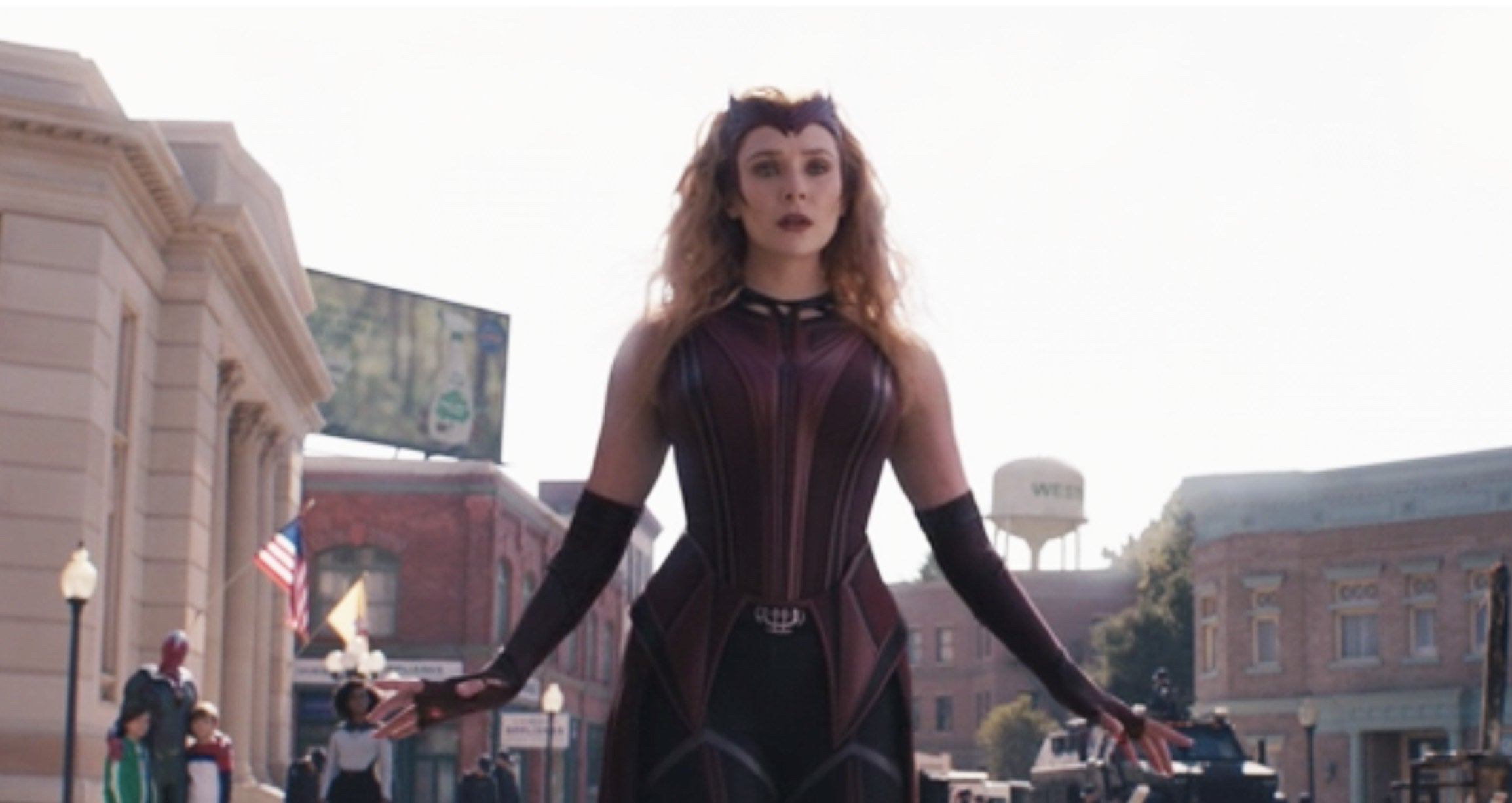 Wanda wears a maroon, blue, and gray uniform