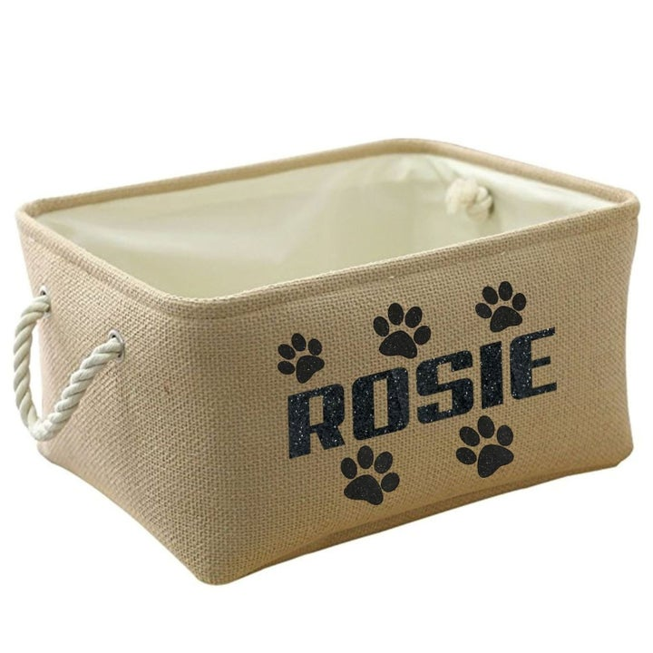 """The basket with the name """"ROSIE"""" on it and paw prints"""