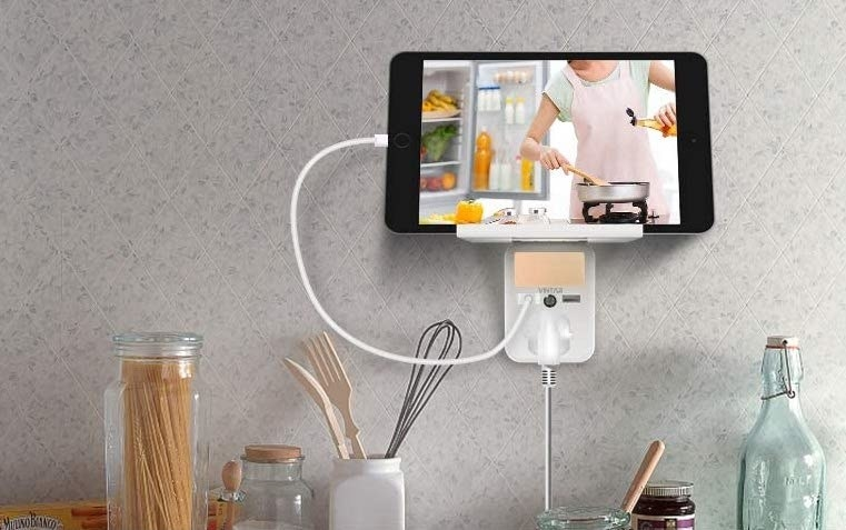 An iPad on the shelf in a kitchen
