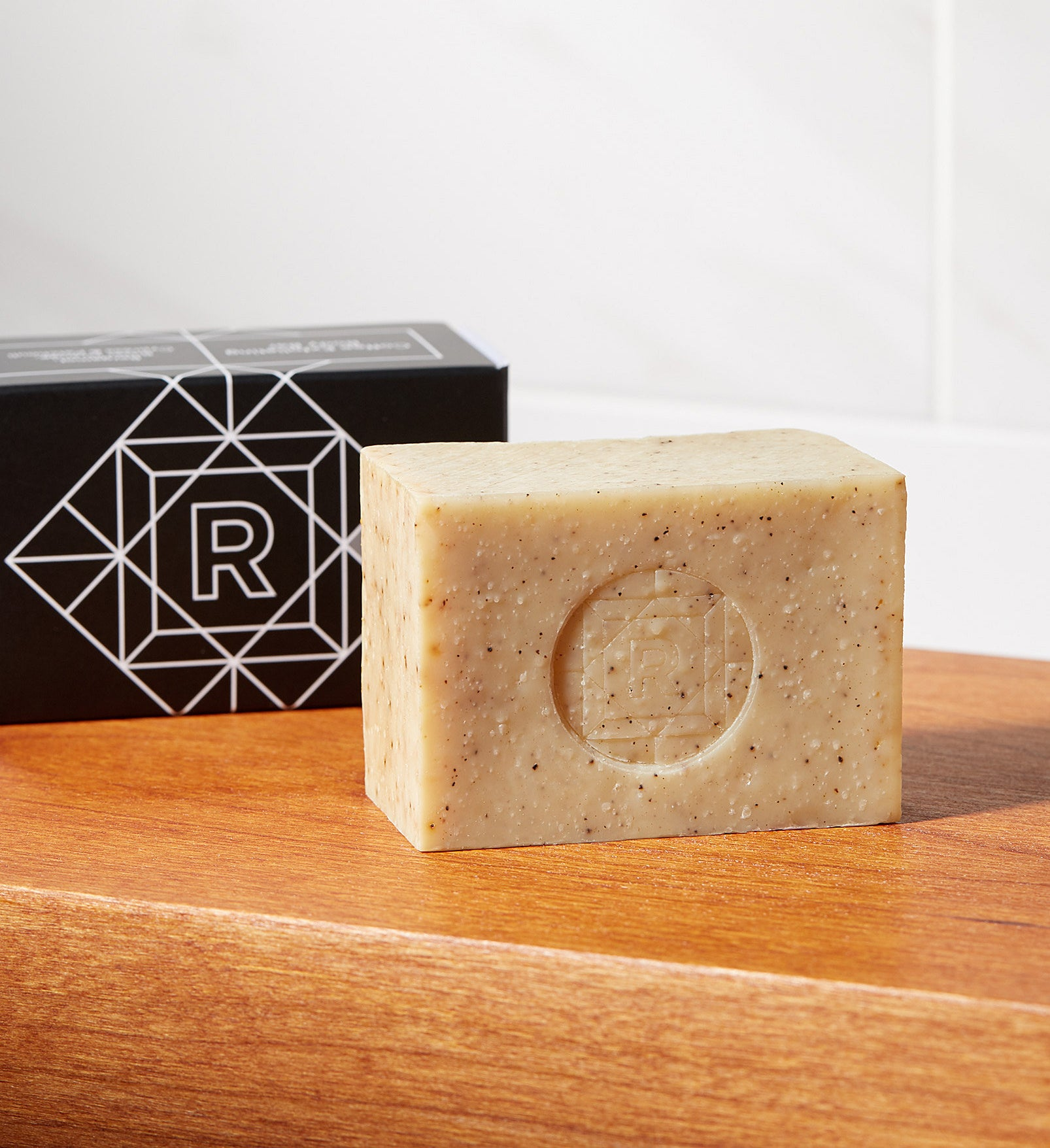 A bar of coffee-infused soap on a counter