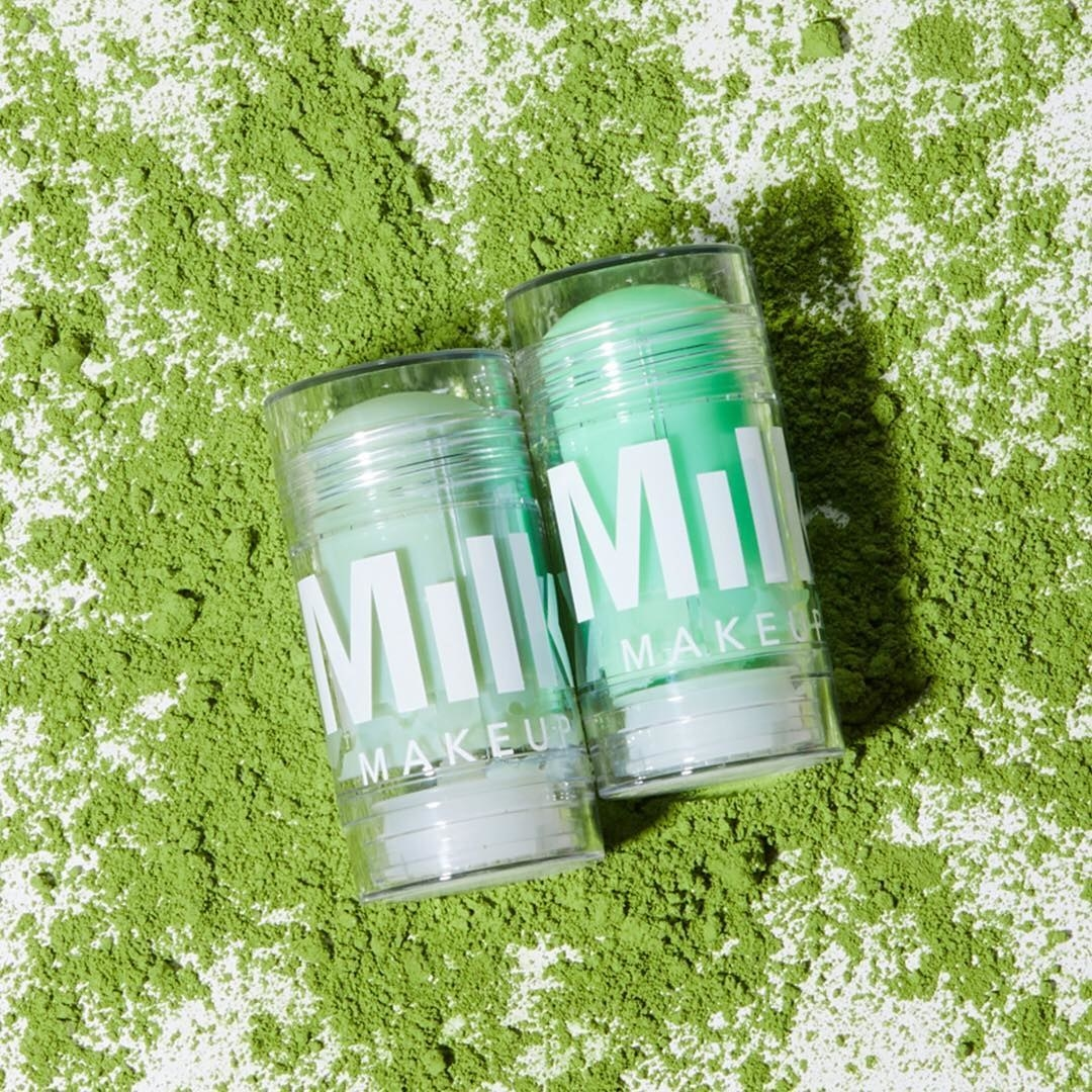 The solid cleanser and toner laid on a bed of matcha powder