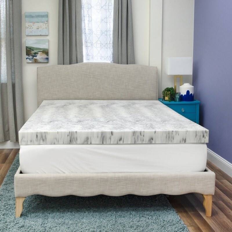 The gray and white marbled mattress pad