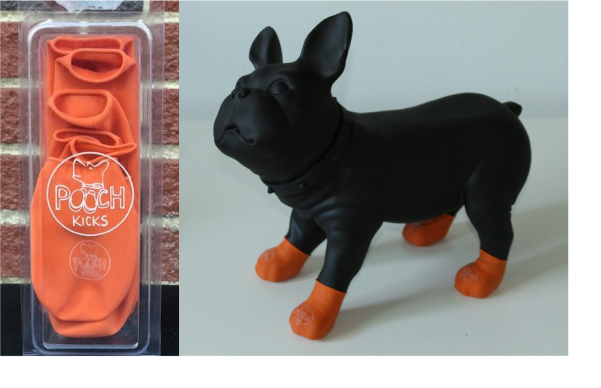 The clear plastic packaging with orange Pooch Kicks inside and a black stuffed animal of a dog with the orange booties on