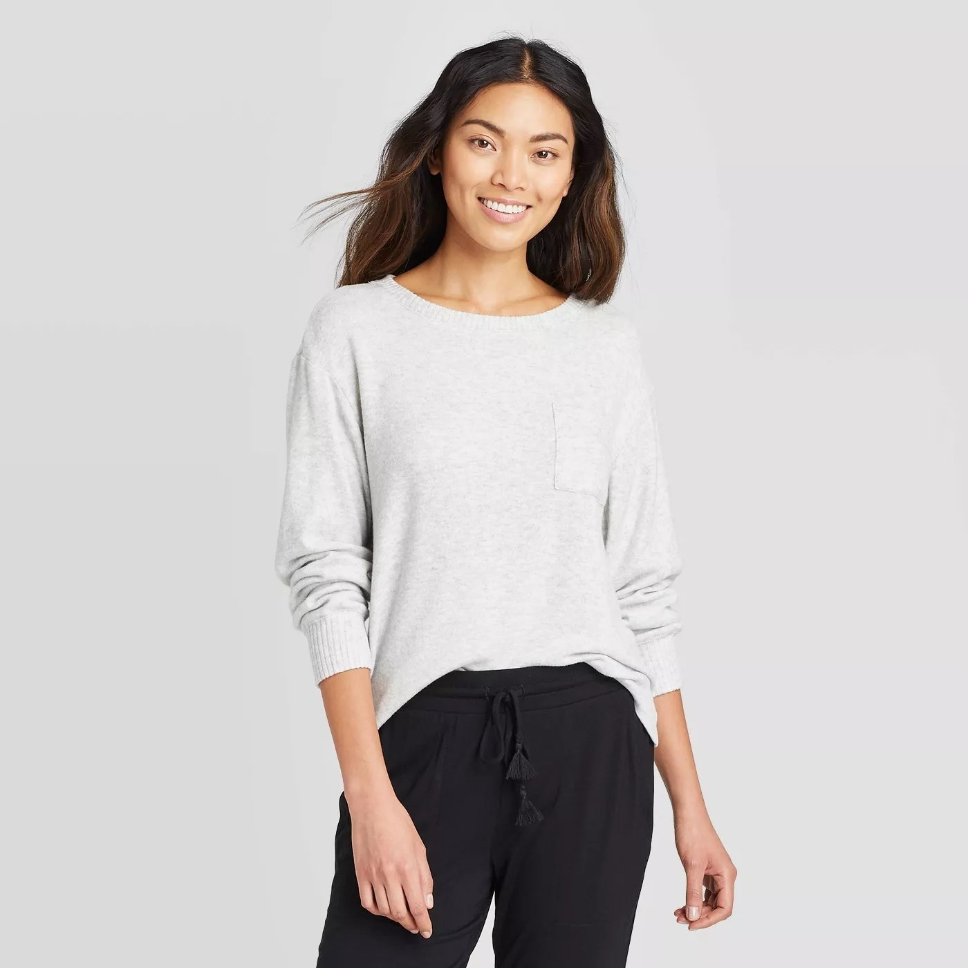The light gray sweatshirt