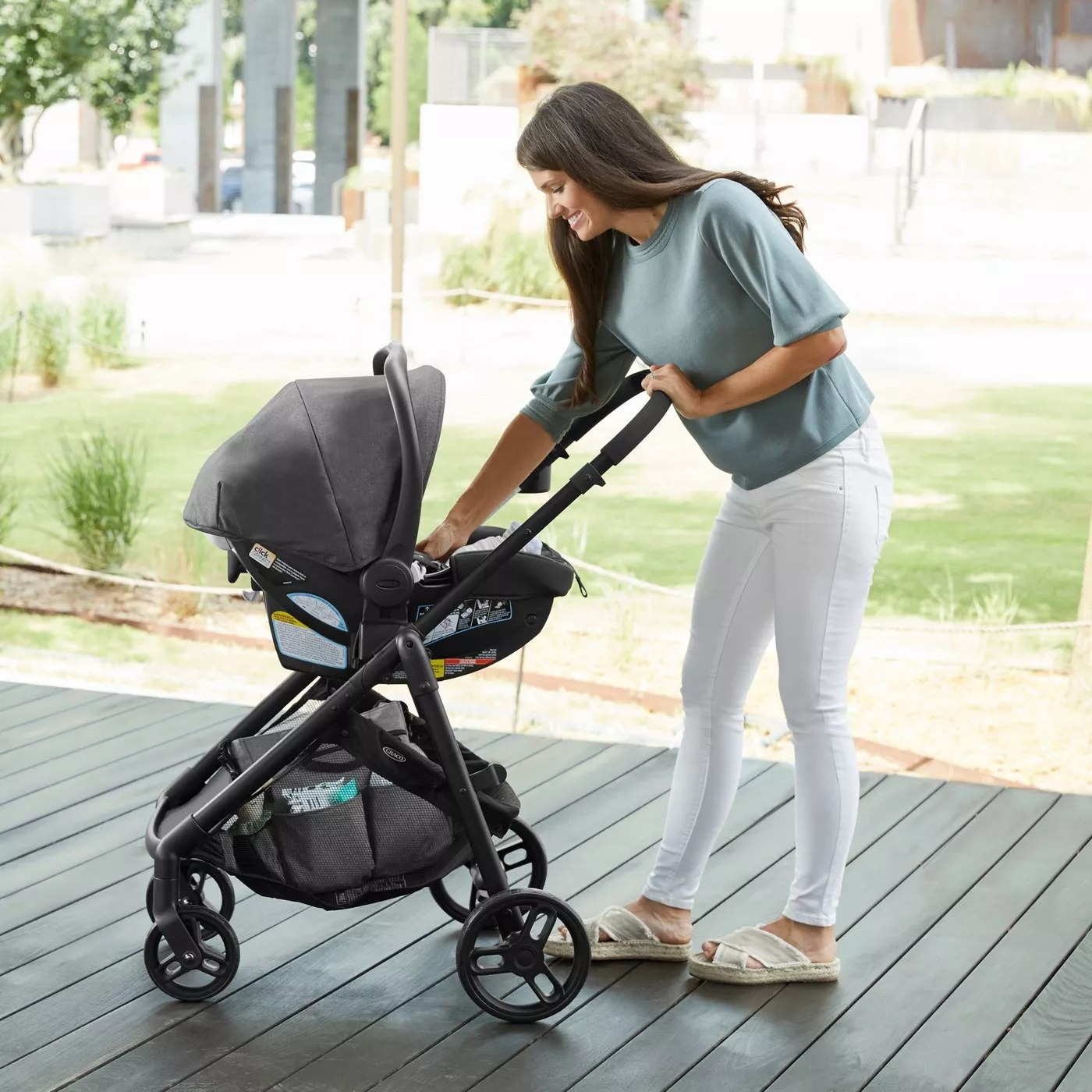 A model with the stroller formatted to carry an infant