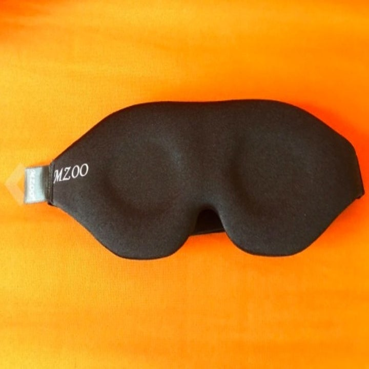 front of a sleep mask that blocks out light