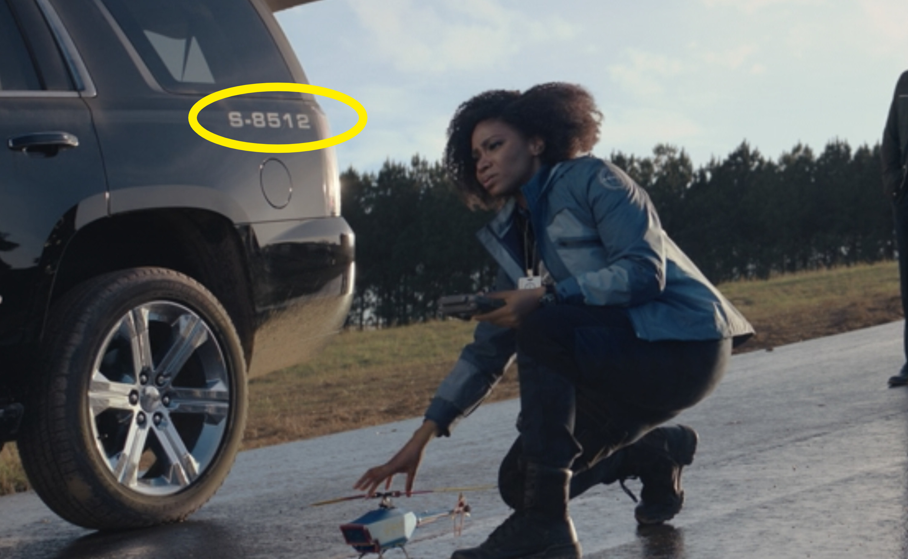 "A circle around ""S-8512"" on Monica's car"