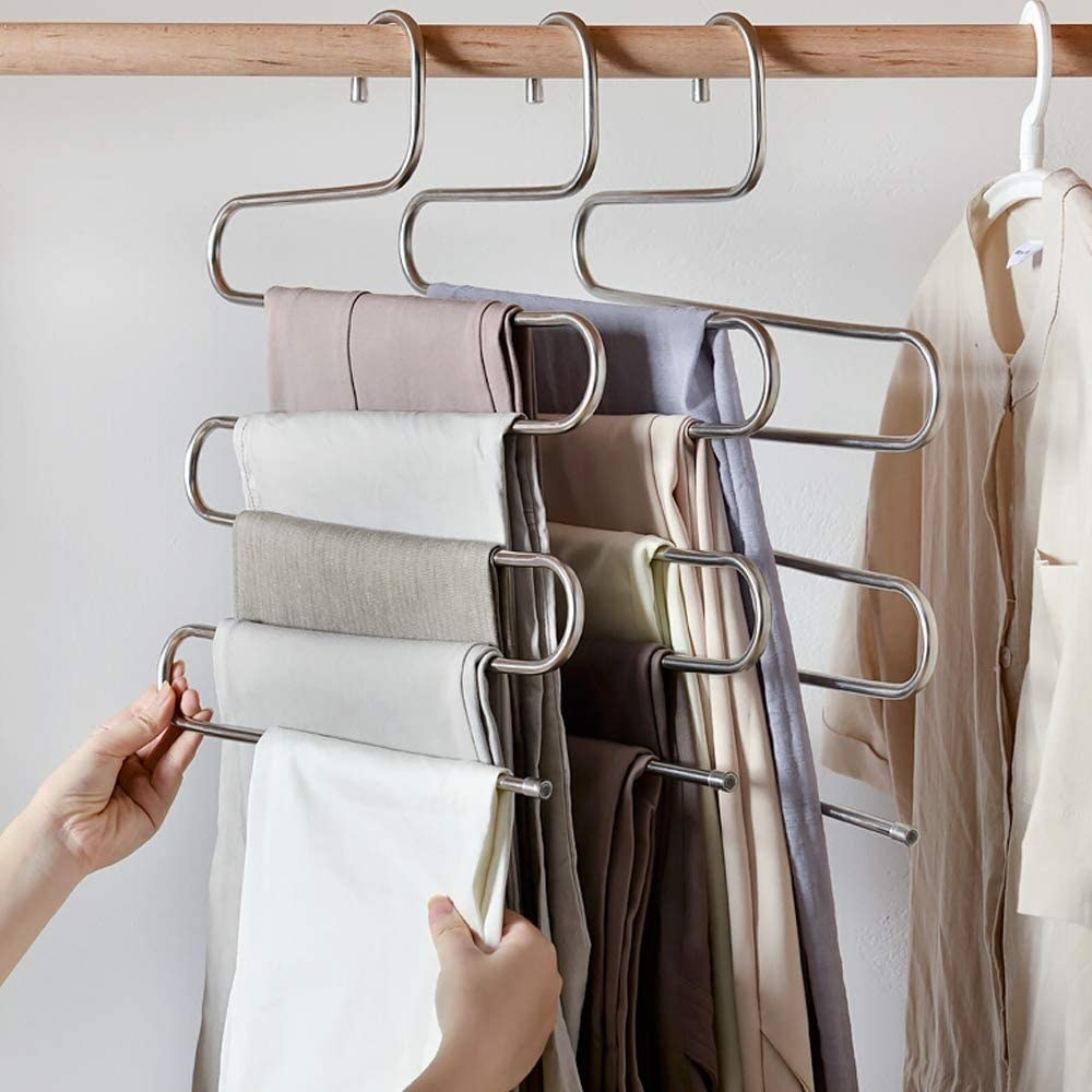 five pairs of pants on the s-shaped hanger