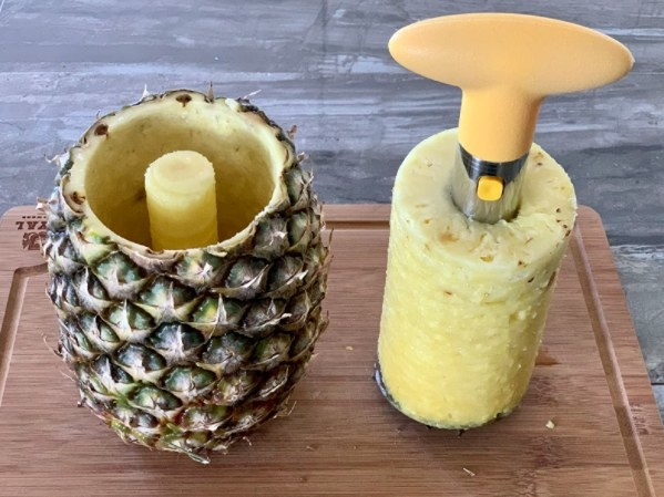 pineapple tool that has sliced, cored, and peeled pineapple
