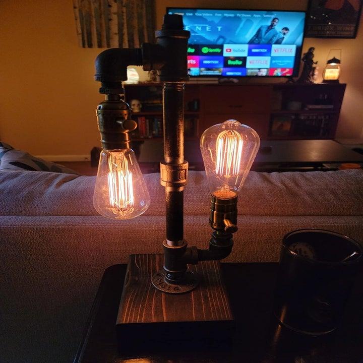 same lamp on reviewer's desk facing a widescreen TV