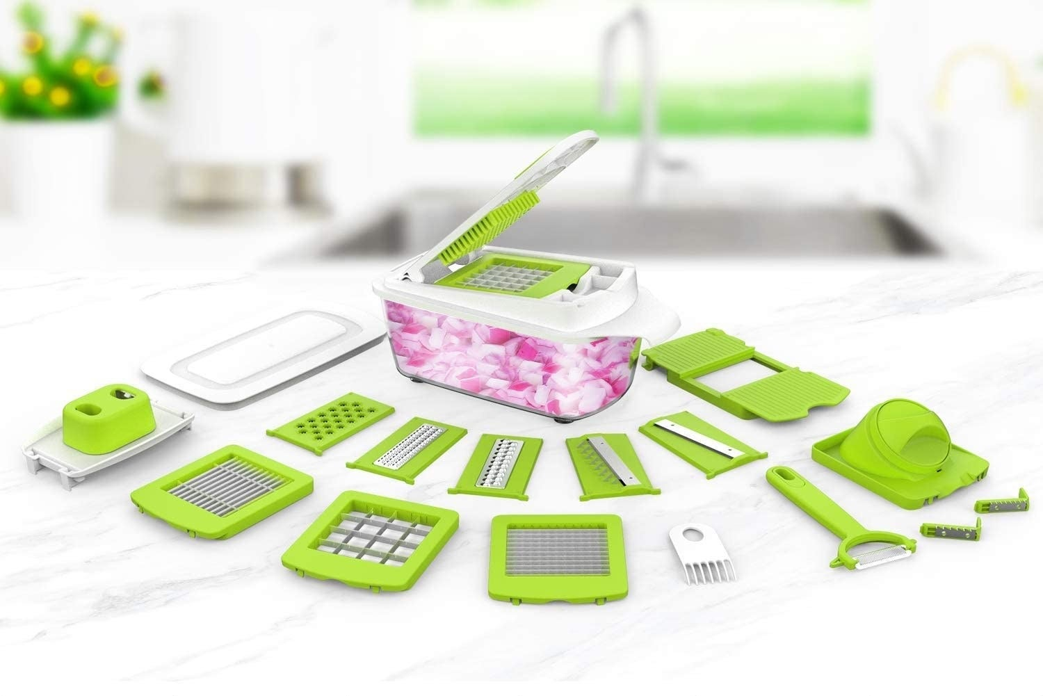 food chopper with all the attachments around it